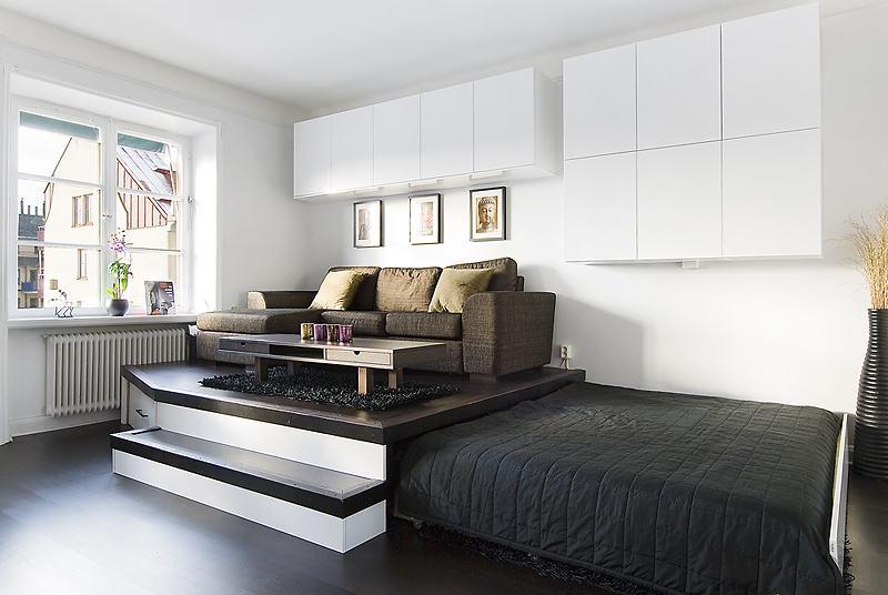 Гостиная в  цветах:   Бежевый, Белый, Светло-серый, Серый.  Гостиная в  стиле:   минимализм.